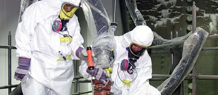 Two men in hazmat suites